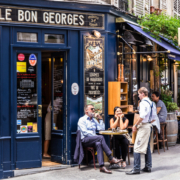 Two guest sitting outside French bistro
