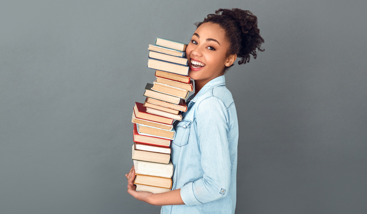 Young woman holding books